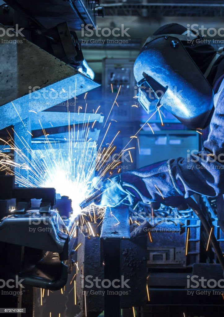 Industrial steel worker speeds motion in factory royalty-free stock photo