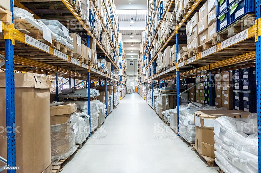Color image of distribution warehouse in huge factory. Logistics,...
