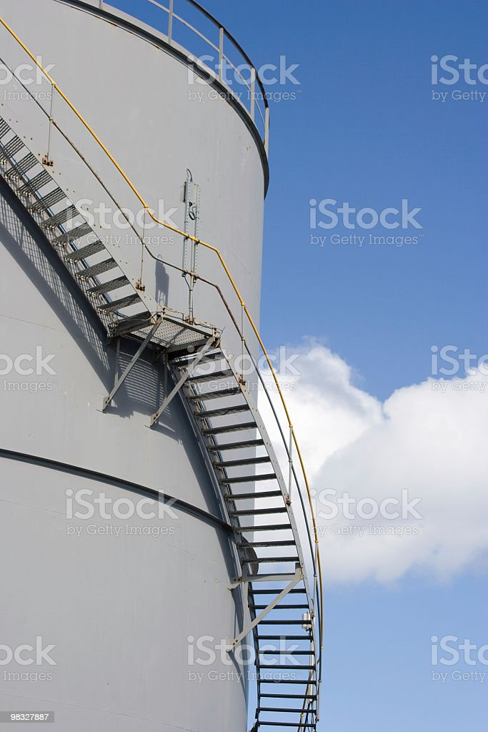Industrial storage tank with metal staircase royalty-free stock photo