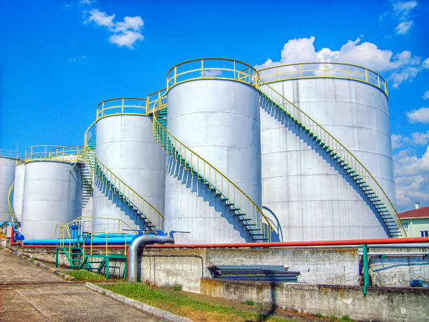 Industrial storage tanks and fire lines. Appearance of an oil and chemical storage facility. Industrial storage tanks and fire lines. Appearance of an oil and chemical storage facility. chemical plant stock pictures, royalty-free photos & images