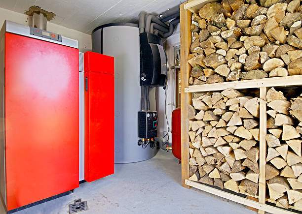 Industrial storeroom with large rack of firewood stock photo