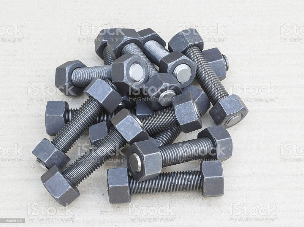 Industrial stud bolts on paper recycle background stock photo