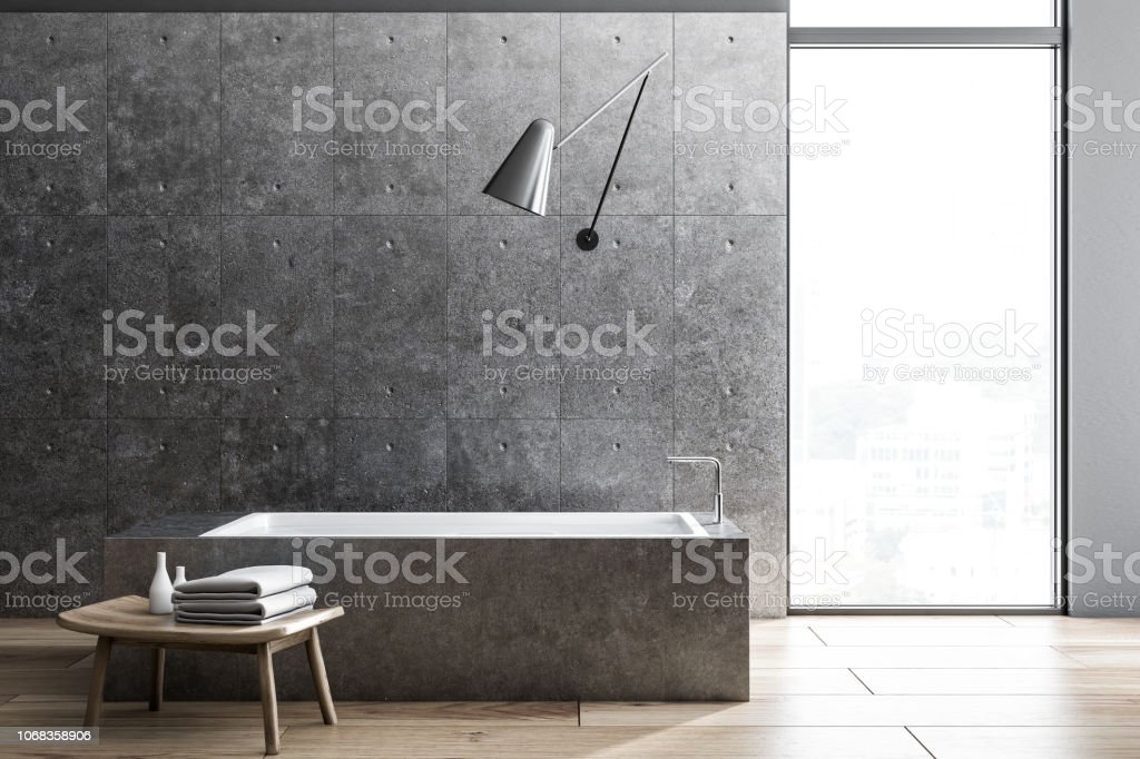 Industrial style bathoom interior, angular tub stock photo