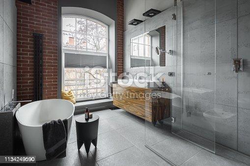 istock Industrial style bathroom 1134249590
