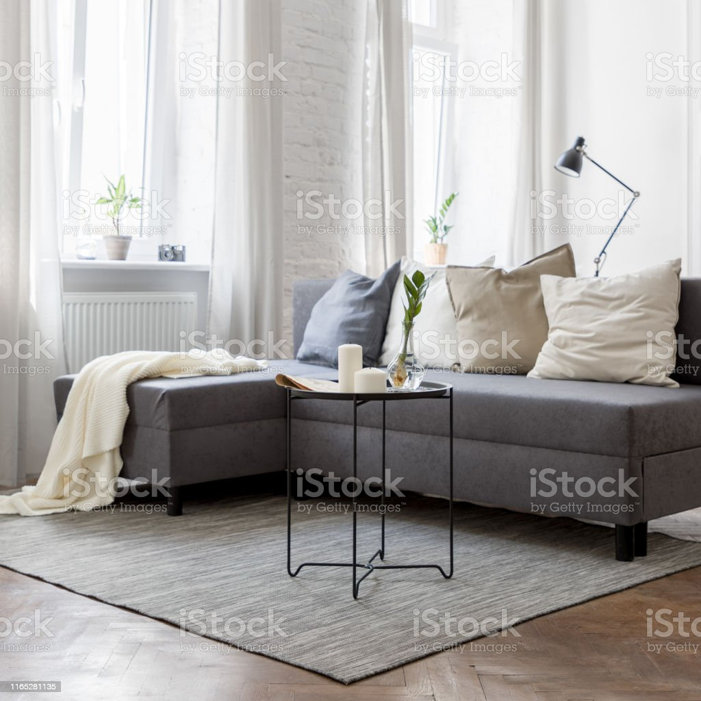 Industrial style living room with sofa, metal coffee table wooden...