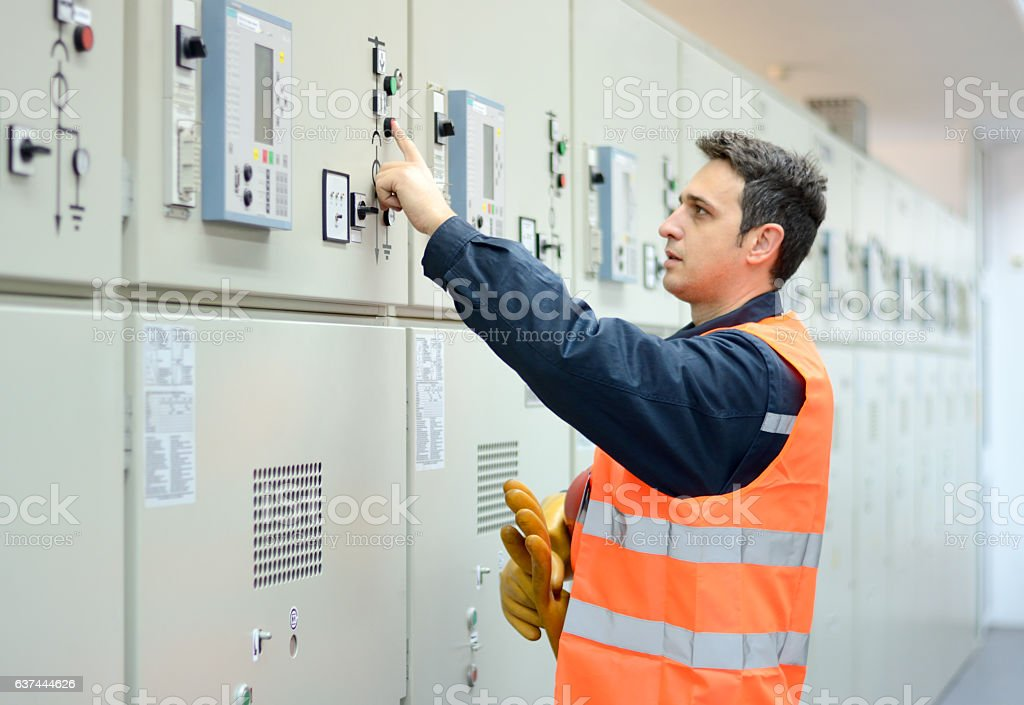 Industrial Technician Operating in Power Substation stock photo