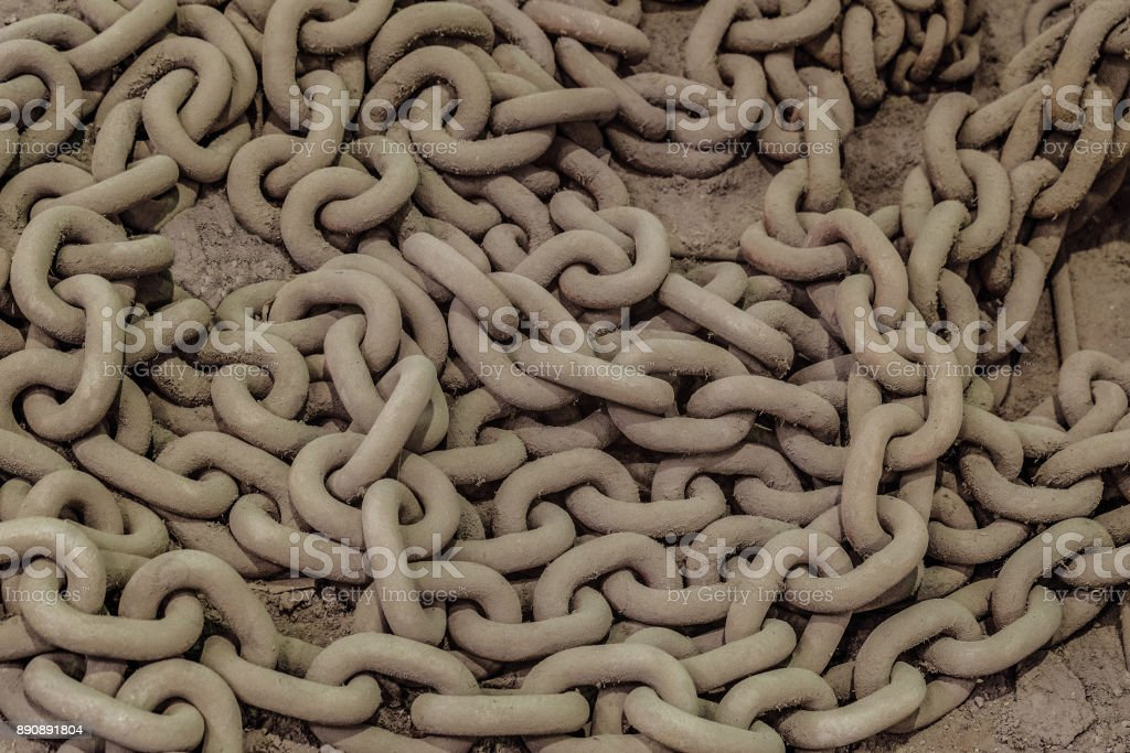 Industrial thick steel chain stacked on heap stock photo