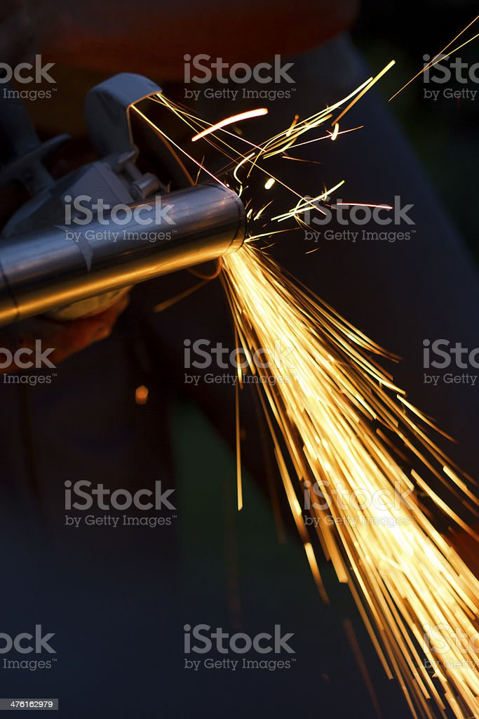 Industrial tool cutting iron tube and spreading red sparks. Handwork...