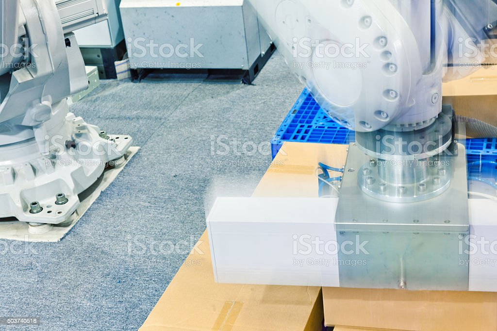 industrial transportation robot arm working stock photo