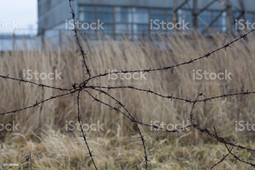 Industrial urban landscape with old barbed wire royalty-free stock photo