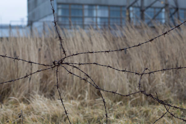 Industrial urban landscape with old barbed wire stock photo