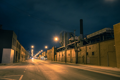 Industrial urban street city night scenery in Chicago with a vintage factory