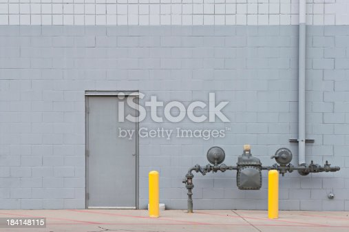 Utility door on gray brick wall