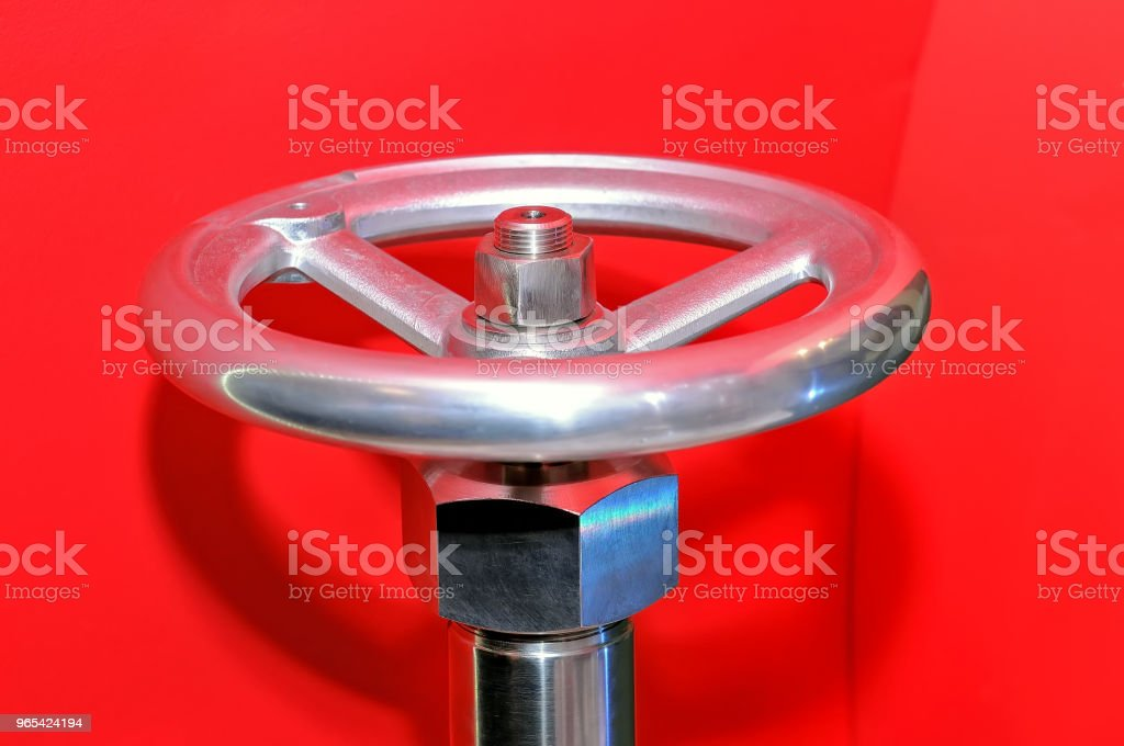 Industrial valve on a red background. royalty-free stock photo