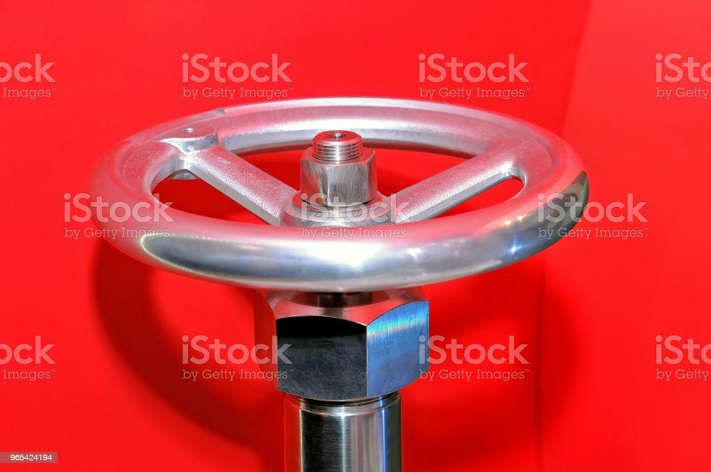 Industrial valve on a red background. zbiór zdjęć royalty-free