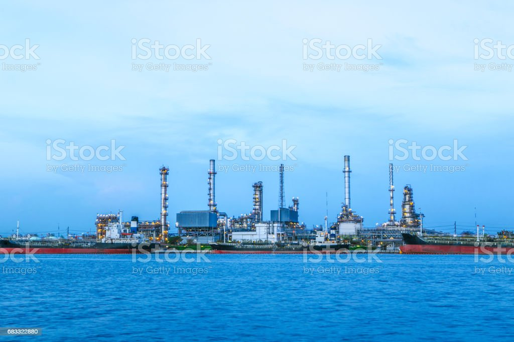 Industrial view at oil refinery plant form industry zone at the Chaophaya river in Bangkok Thailand zbiór zdjęć royalty-free