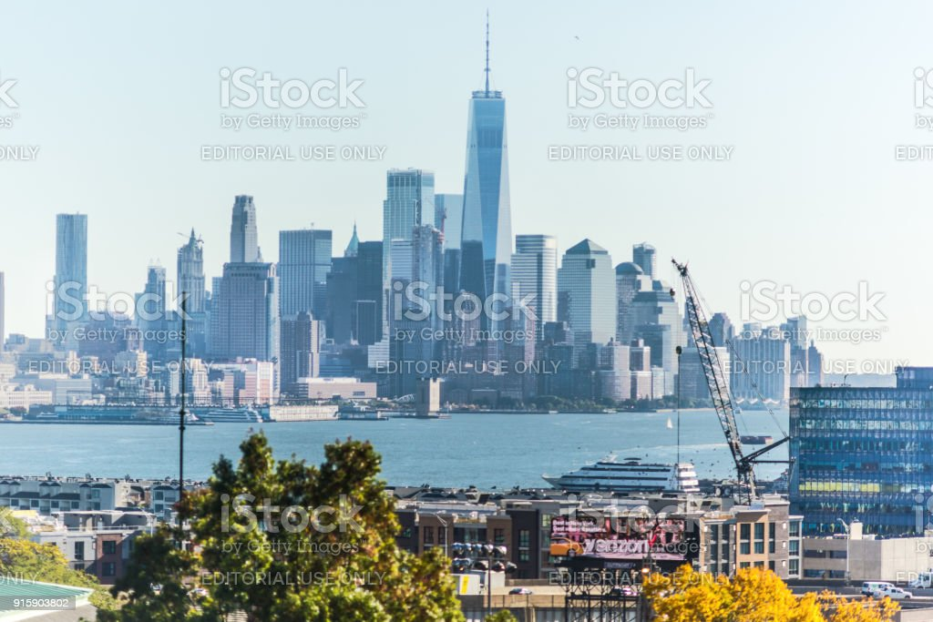 Industrial view of New Jersey with cityscape skyline of Manhattan, NYC, New York City, port, ship, lower downtown, verizon billboard stock photo