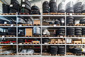 Industrial warehouse of spare parts. On the shelves are many tires.