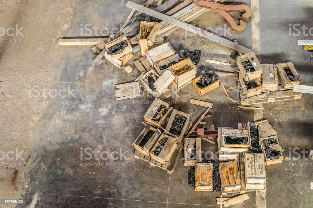Industrial warehouse with open boxes for hardware (bolts, washers, nuts). View from the top. stock photo