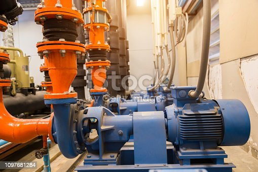 istock industrial water pump and water pipes. 1097681284