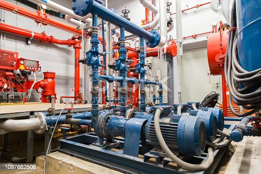 istock industrial water pump and water pipes. 1097682506