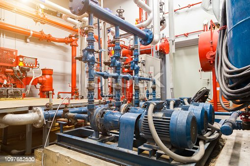 istock industrial water pump and water pipes. 1097682530
