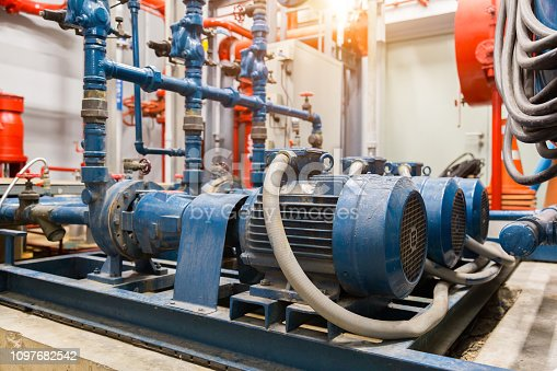 istock industrial water pump and water pipes. 1097682542