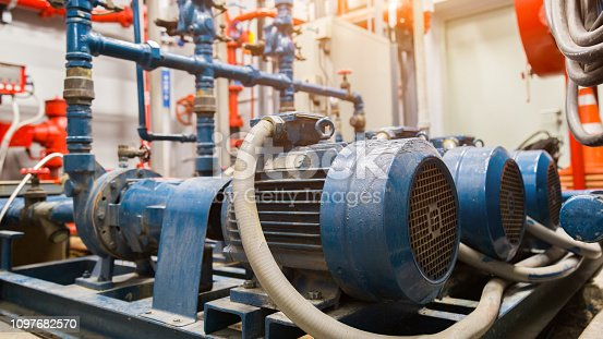 istock industrial water pump and water pipes. 1097682570