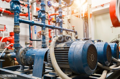istock industrial water pump and water pipes. 1097682578