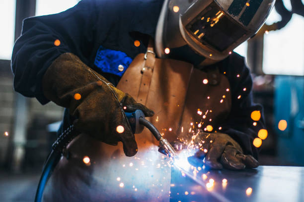 Industrial Welder With Torch Industrial Welder With Torch manufacturing stock pictures, royalty-free photos & images