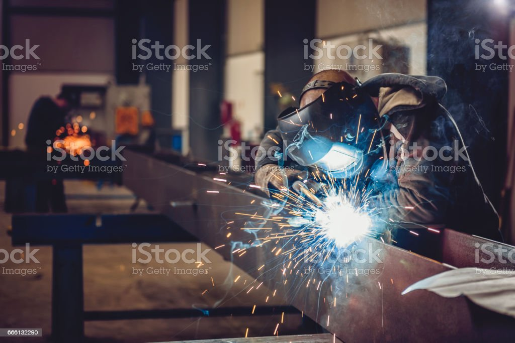 Industrial Welder With Torch stock photo