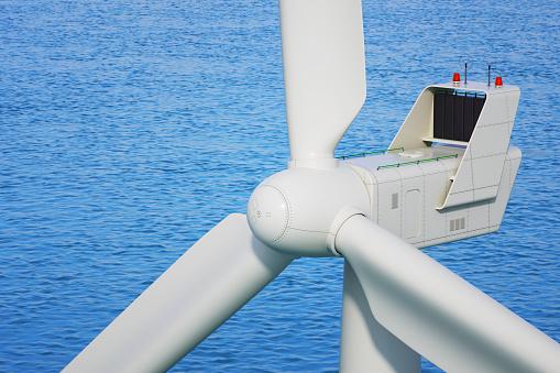 Industrial wind turbine close up in sea