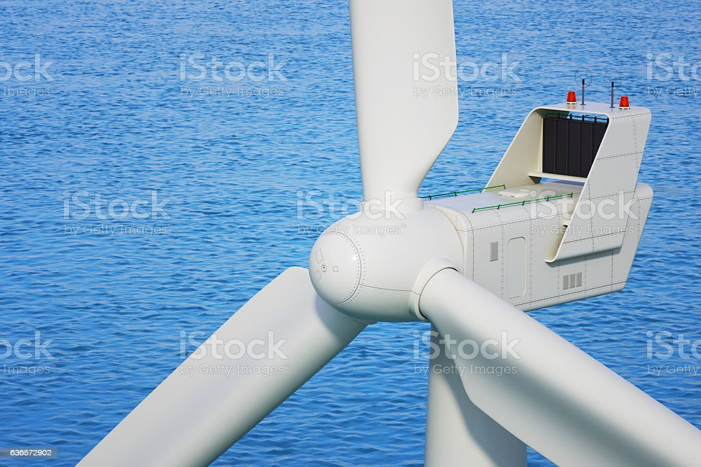 Industrial wind turbine close up in sea stock photo