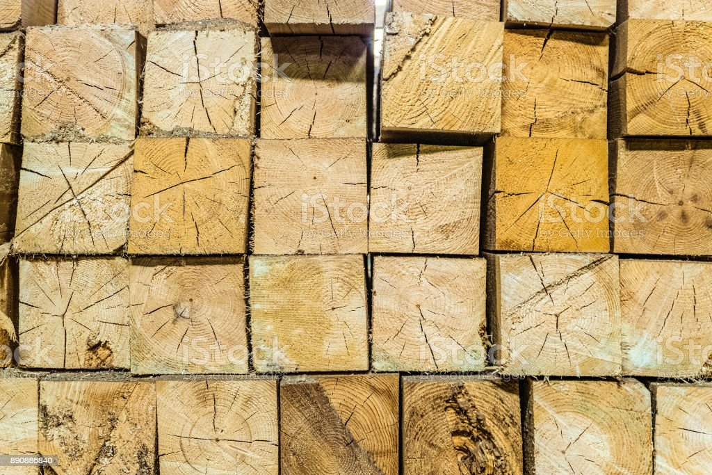 Industrial wood beams stacked in rows. Wooden blocks background. stock photo