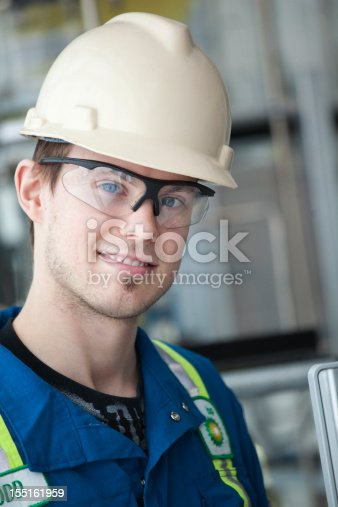 Worker surrounded by industrial equipment