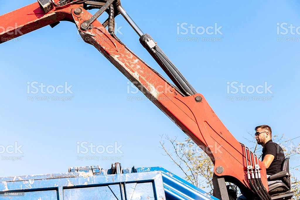 industrial worker at the controls of a crane stock photo