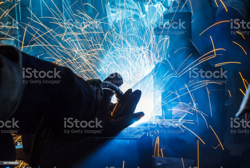 Industrial Worker at the factory welding closeup stock photo