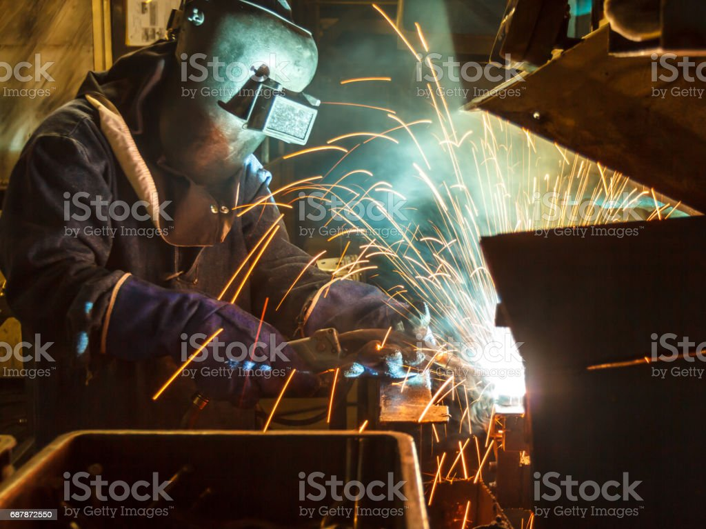 Industrial Worker at the factory welding stock photo