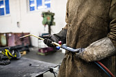 Unrecognizable industrial worker at the welding factory.