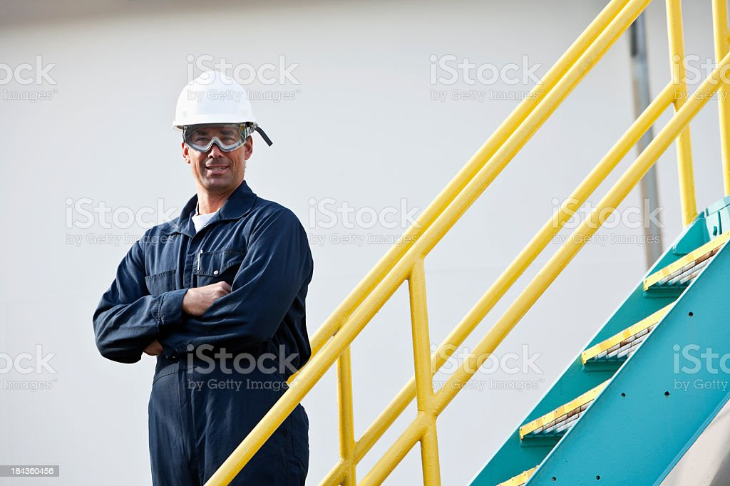 Industrial worker by metal staircase stock photo