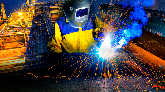 Industrial Worker In Action Welding Close Up Stock Photo ...