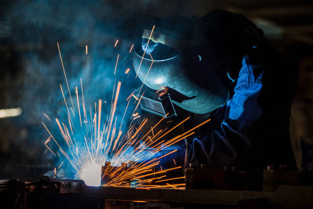 industrial worker is welding in factory industrial worker is welding in factory naval base stock pictures, royalty-free photos & images