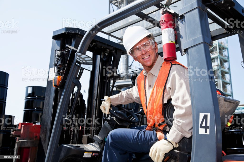 Industrial worker on forklift stock photo