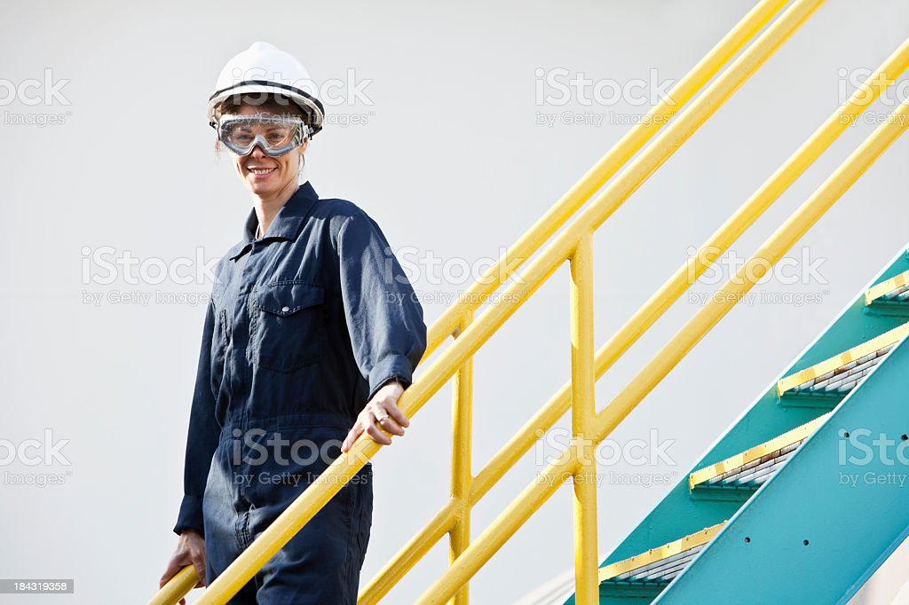 Industrial worker on metal staircase stock photo
