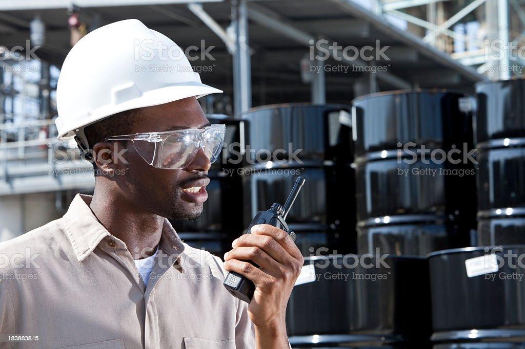 Industrial worker on walkie-talkie royalty-free stock photo