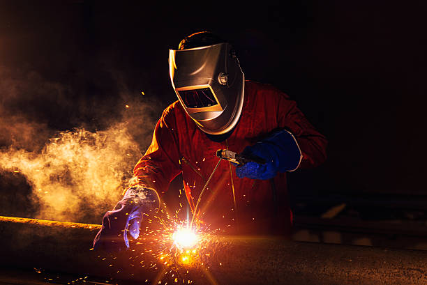 Industrial Worker Industrial Worker at the factory welding closeup metalwork stock pictures, royalty-free photos & images