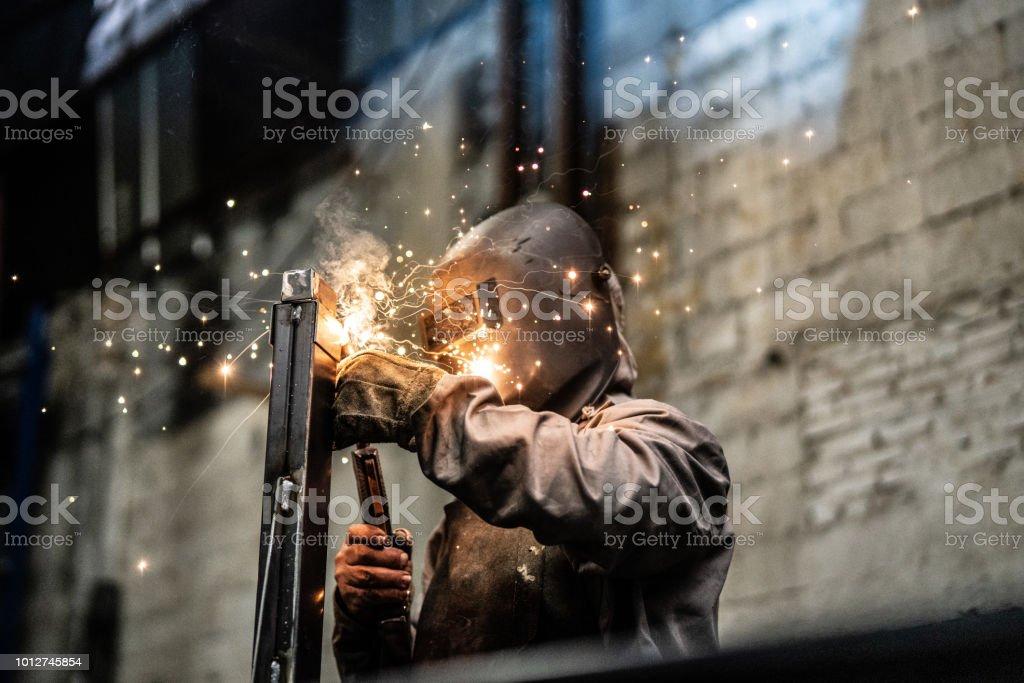 Industrial Worker welding steel stock photo