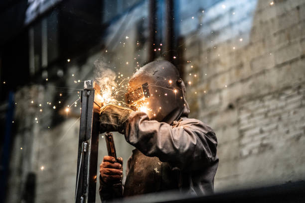 Industrial Worker welding steel Business and Industry metalwork stock pictures, royalty-free photos & images