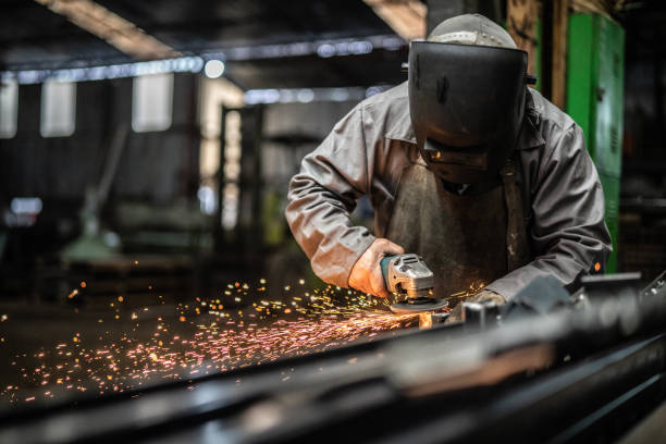 Industrial Worker welding steel Business and Industry grinding stock pictures, royalty-free photos & images