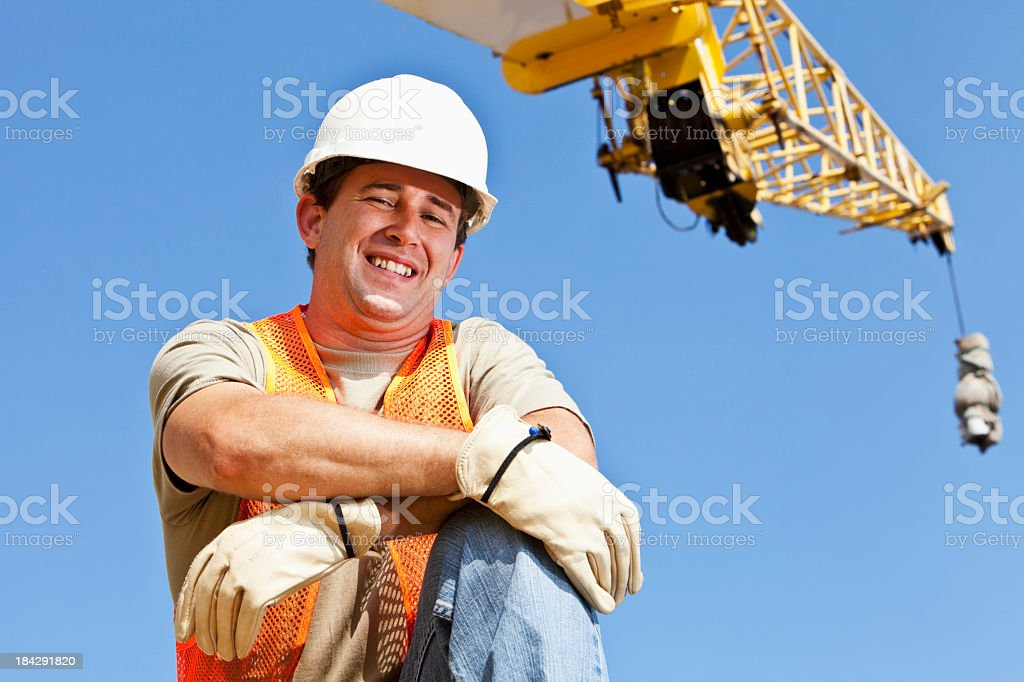 Industrial worker with crane stock photo